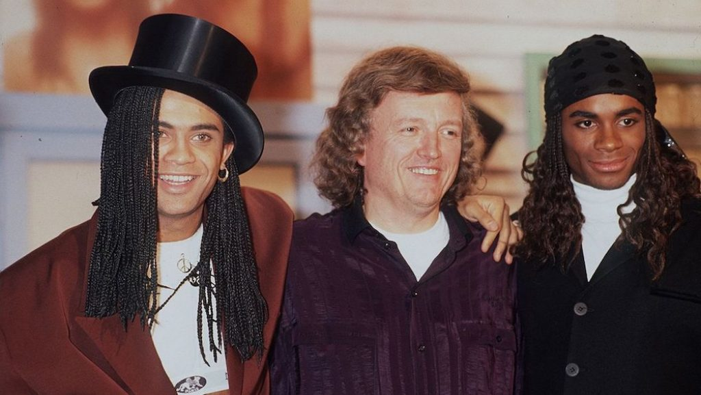 Frank Farian (center) with Milli Vanilli. Rob Pilatus (L) and Fab Morvan (R).