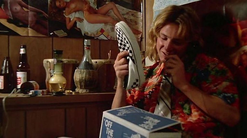 A screenshot of Fast Times at Ridgemont High (1982) shows Spiccoli with his new checkered Vans shoes.