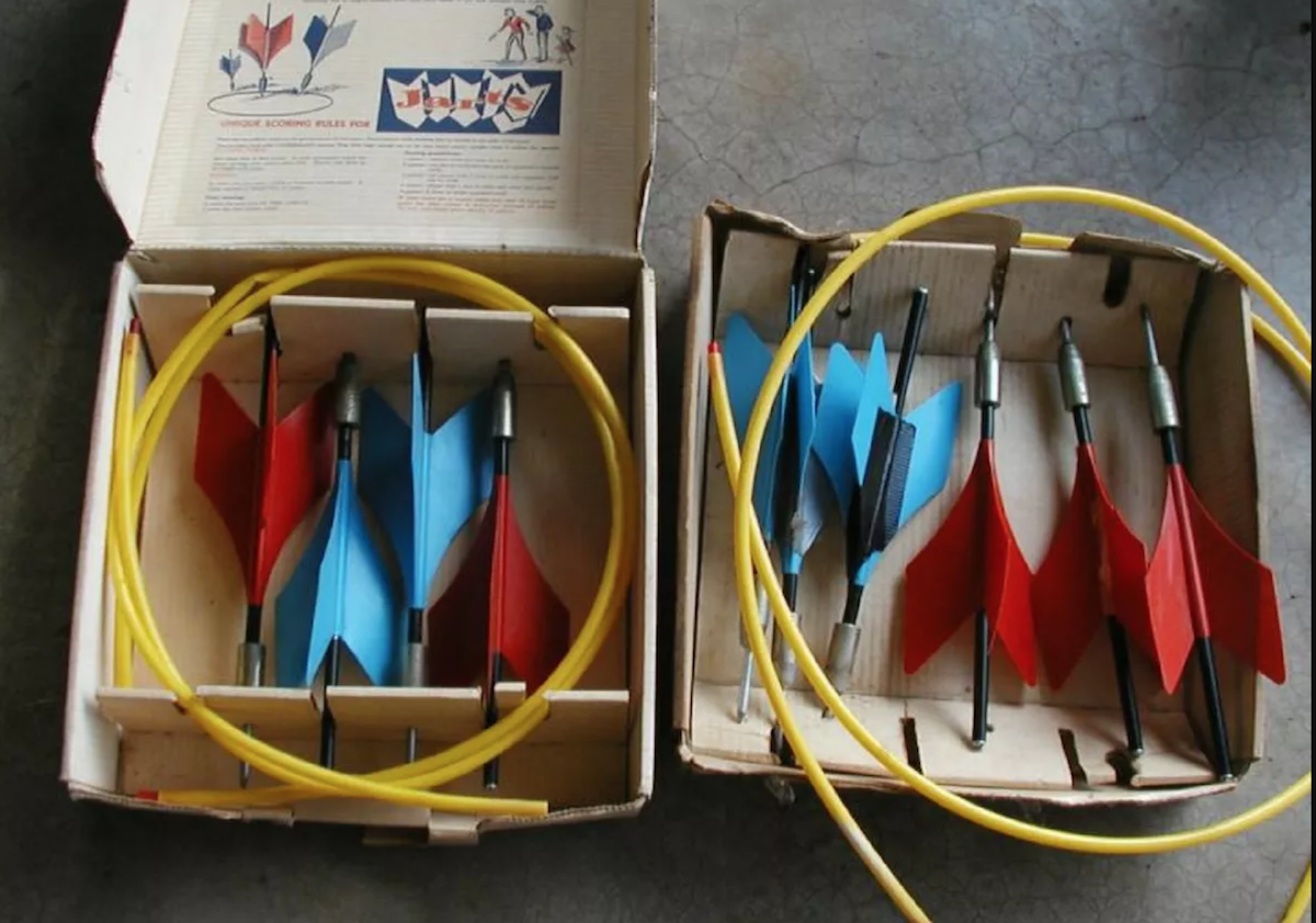 opened box of lawn darts or jarts