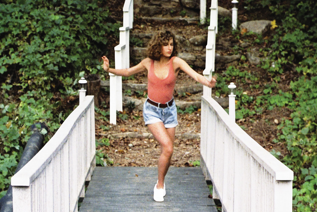 A screenshot of the movie Dirty Dancing (1987) where Baby Houseman is wearing white Keds.